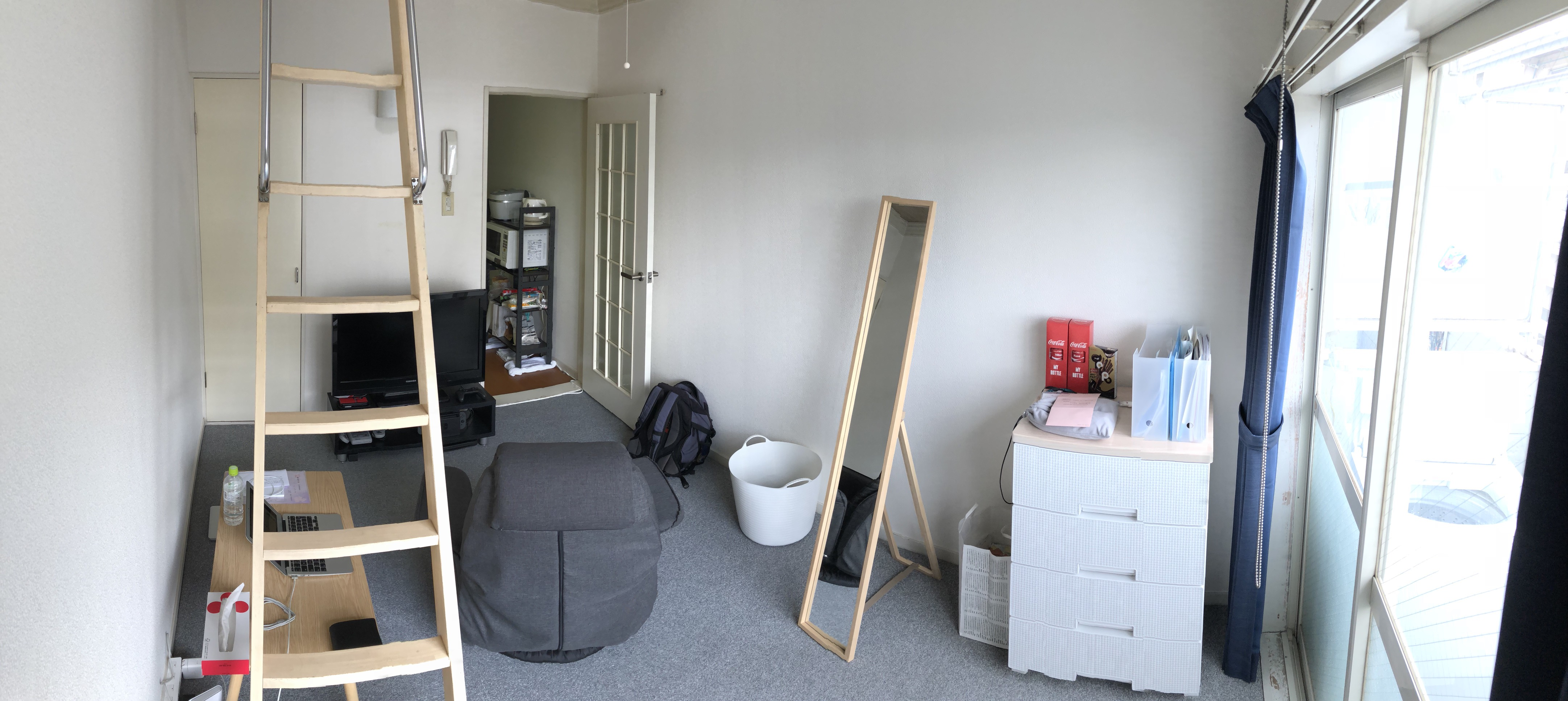 (Caption) Panorama shot! Some things that were not visible in the previous shot include storage closet on the left side, obviously the TV and a TV stand in the middle and Kumi's cabinet on the left side.